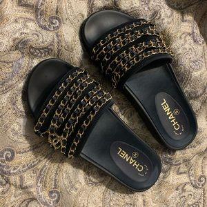 Chanel slides.